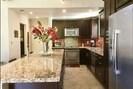 Kitchen with 12 foot granite island