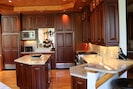 Main house kitchen with high end finishes & appliances