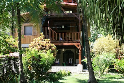 The house is completely nestled into the surrounding gardens- close to nature!