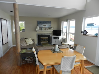 Dining & Living area, Gas Fireplace, LCD TV & views of the water