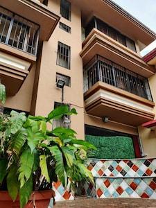 Green Haven Villa facade and patio seating