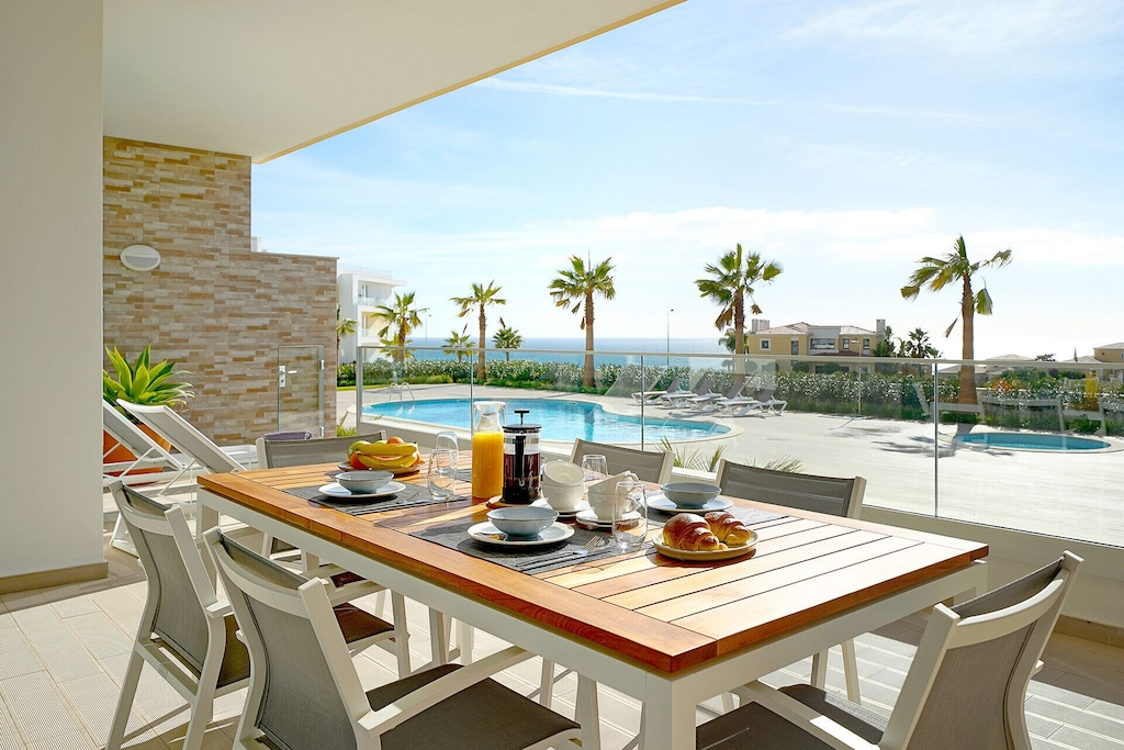 Breakfast table on the terrace of a Lagos rental condo overlooking the swimming pool