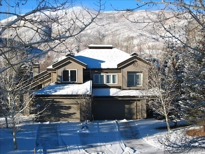 wintertime with plowed driveway and mountain views