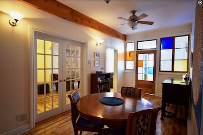 OTHER VIEW OF THE DINING ROOM WITH DOORS TO THE BIG DEN/LIVING ROOM