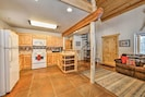 Enjoy the spacious furnished kitchen with custom built cabinets and tile counter