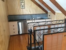 Self contained kitchen space with stove top, cooking equipment ect