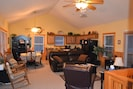 Guests can relax with the easy access to the kitchen and screened in porch
