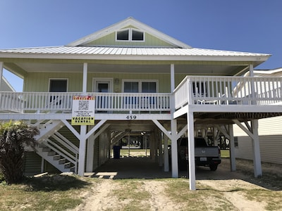 """View of house and deck from the beach. That's why it's called """"almost oceanfron"""