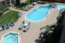 View of pool and hot tub from balcony