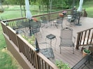 550 square foot deck with six rocking chairs.