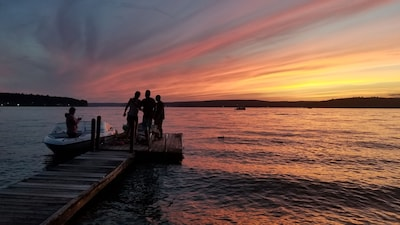 Guest enjoying a spectacular sunset at the dock.