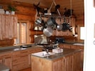 Kitchen with professional applicances and cookware