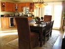 One of 3 dining areas that opens to patio, wet bar behind, with wine fridge!
