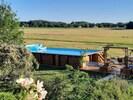 piscine   Dimension : 6 mètres par 12mètres Hauteur de l'eau : 1m40