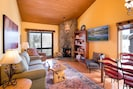 Airy living room, alpine ceiling, large sliding glass doors to Nat Forest. views