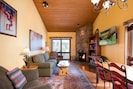 Well lit, cozy, wood floor, granite &  natural wood fireplace. Nat Forest view