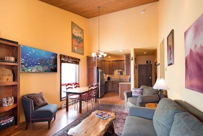 "Vaulted ceiling, unified kitchen/dining/living room. 55"" LED Smart TV w/soundbar"