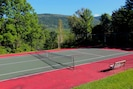 Enjoy a game of tennis right outside the house.