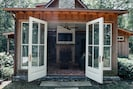 open French doors to the outside fire pit area
