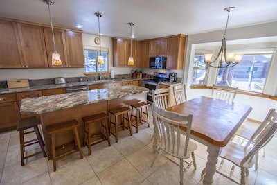 Large gourmet fully stocked Kitchen with Dining Area