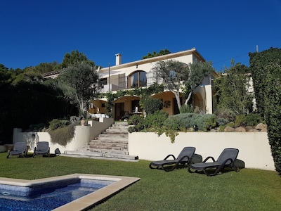 Villa from the grassed area by the pool