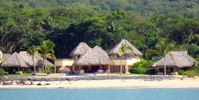 Las Palapas main building and 2 casitas.  200 feet of beach front.