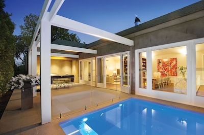 Outdoor area with heated plunge pool and a BBQ