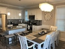 Dining Room table seats 9 comfortably and Kitchen Island has 4 bar stools