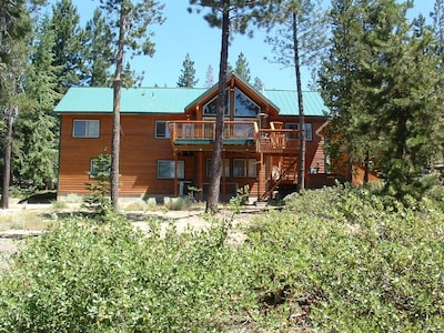 Home is on one acre of wooded landscape