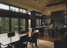 View of Gourmet Kitchen and Dining Area with Sliding Glass Wall opening to Deck