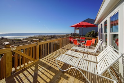 Ocean side deck with plenty of lounging for all!