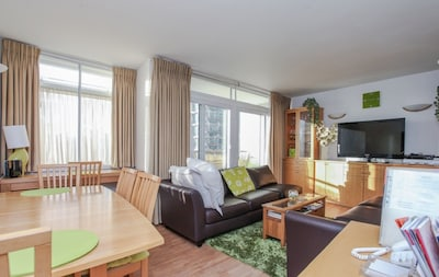 Living Room is bright and sunny with access to a balcony