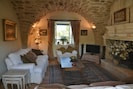 The sitting room with huge inglenook fireplace