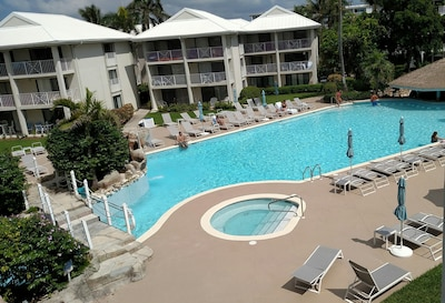 Largest swimming pool on 7 Mile Beach. View of hot tub and pool from our balcony