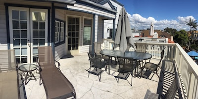 Private deck area with grill.  Umbrella table seats 8.