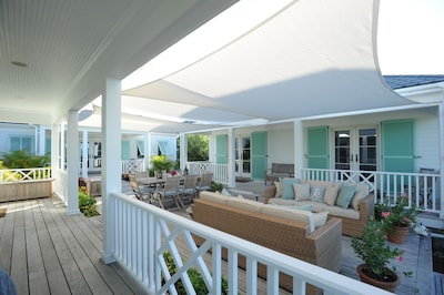 Fantastic Deck area with shade sails make this an outdoor living room!