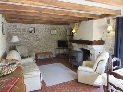 Salon avec canapé et fauteuils en cuir