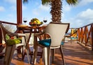Shaded dining area on  the private balcony over looking the Sea.
