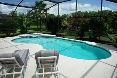 Pool area which overlooks a small lake to the rear. Good for wildlife and fishing.