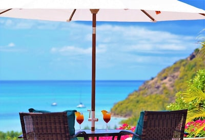 A perfect spot for two overlooking the Caribbean Sea.