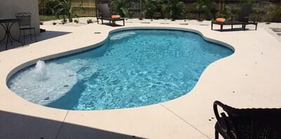 Paradise found. Resort style pool,sun shelf, seat, bubbler, grill, patio,play ar