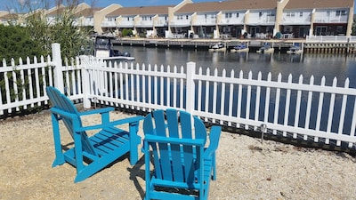 Have a seat, grab a drink, and relax as you watch the birds and boats go by.