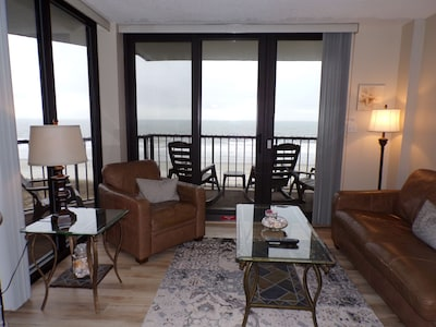 Oceanfront living room with leather furniture