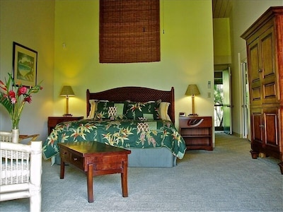 #1304 King bed with cathedral ceilings and mahogany armoir, love seat.
