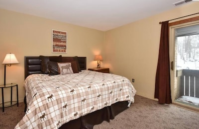 King Master with flat screen tv, balcony and full bath 1st floor