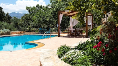 Outdoors area with 60 sqm swimming pool, outdoor furnitures and gardens!