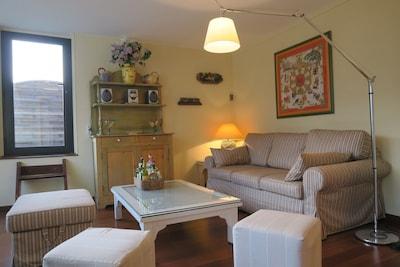 Le salon avec accès terrasse