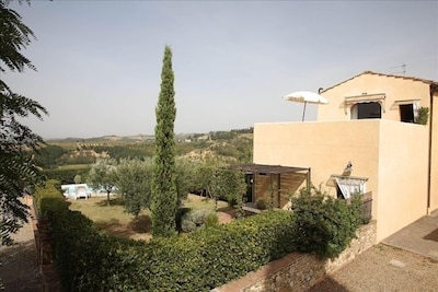 The Villa from outside with private garden and pool