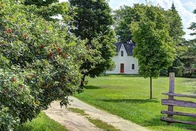 Classic 1861 Ontario farmhouse.  Apple trees,  maple trees and cedar rail fences