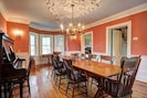 Dining room with Harvest table for 12 -14, plus piano!